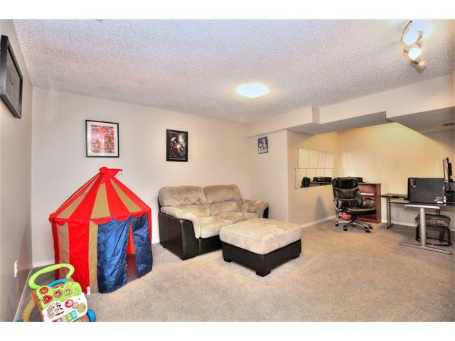 Photo 25: Photos: 527 EVERMEADOW Road SW in Calgary: Evergreen House for sale : MLS®# C4056995