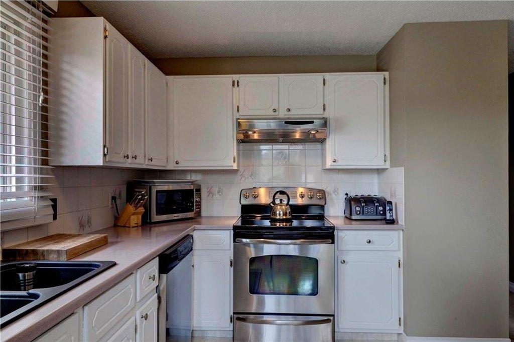 Photo 6: Photos: 110 DEERFIELD Terrace SE in Calgary: Deer Ridge House for sale : MLS®# C4123944
