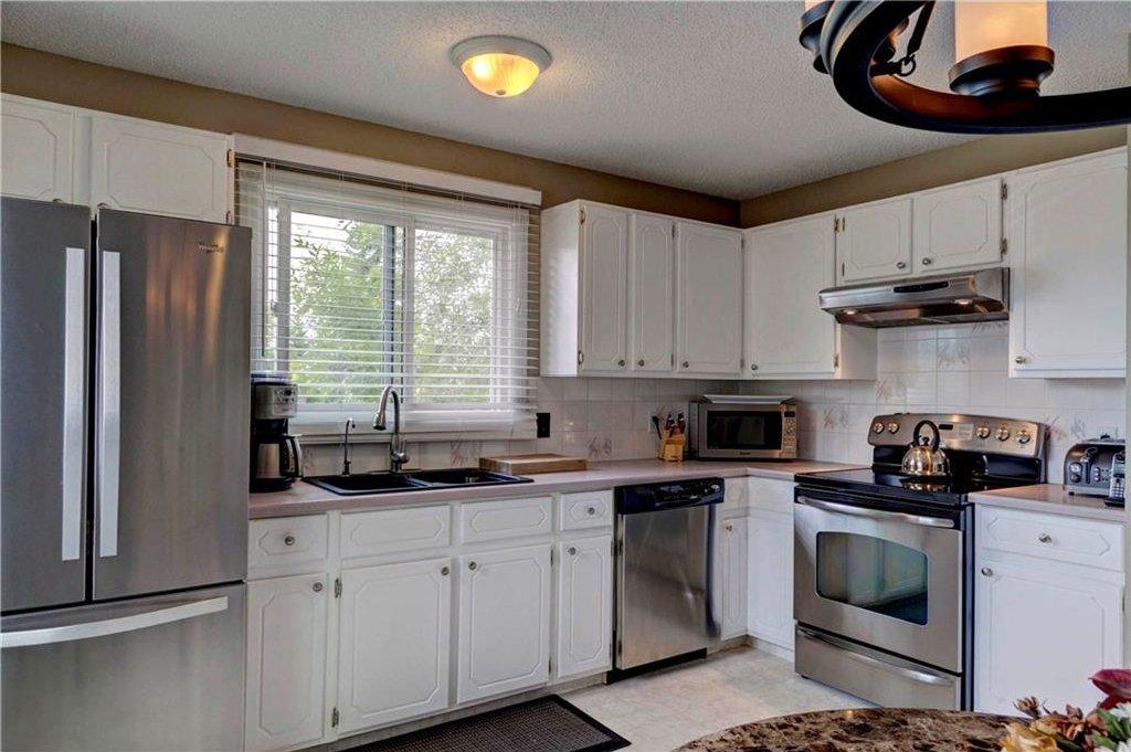 Photo 7: Photos: 110 DEERFIELD Terrace SE in Calgary: Deer Ridge House for sale : MLS®# C4123944