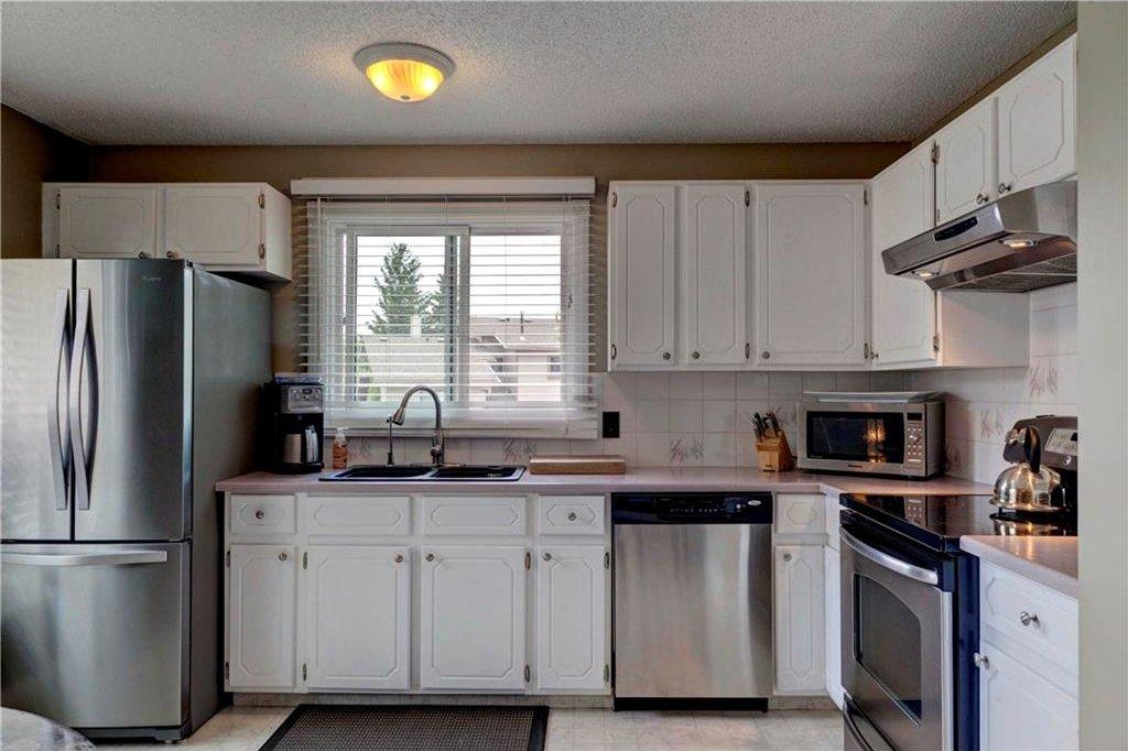 Photo 13: Photos: 110 DEERFIELD Terrace SE in Calgary: Deer Ridge House for sale : MLS®# C4123944