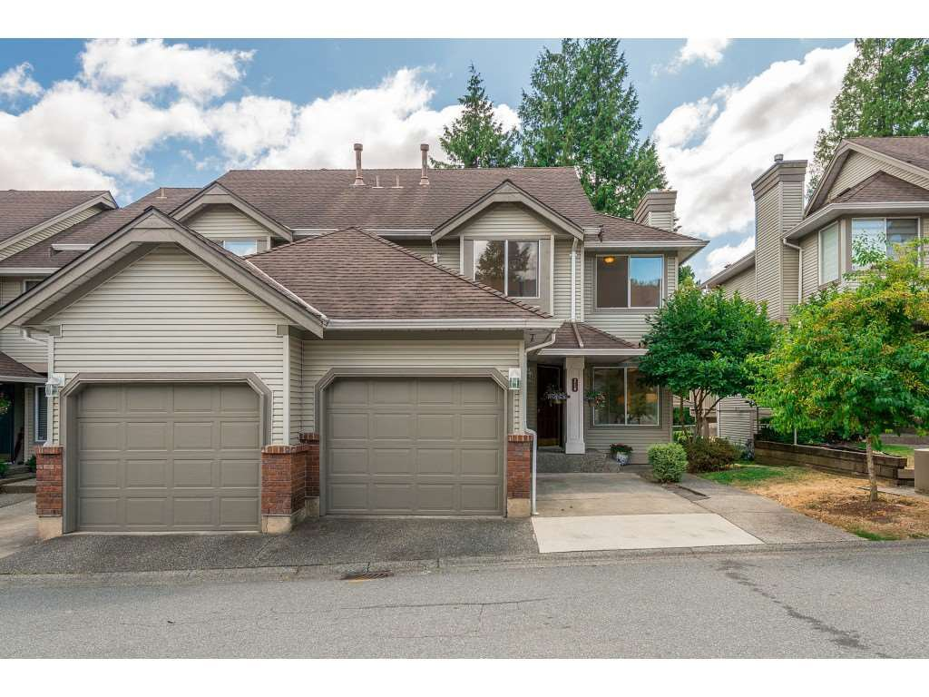 "Main Photo: 210 13900 HYLAND Road in Surrey: East Newton Townhouse for sale in ""Hyland Grove"" : MLS®# R2295690"