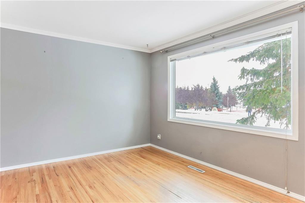 Photo 8: Photos: 662 REGAL Park NE in Calgary: Renfrew Row/Townhouse for sale : MLS®# C4210366