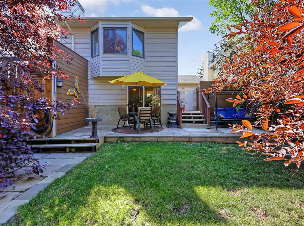 Wonderful and PRIVATE backyard with 2 expansive deck areas, landscaping, and mature trees!