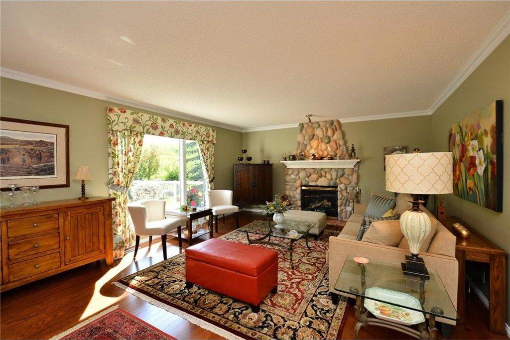Photo 5: Photos: 52 GLENEAGLES View: Cochrane House for sale : MLS®# C4125774