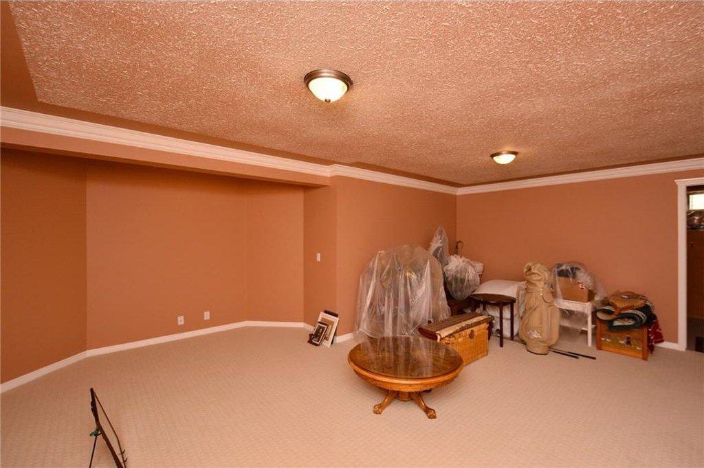 Photo 37: Photos: 52 GLENEAGLES View: Cochrane House for sale : MLS®# C4125774