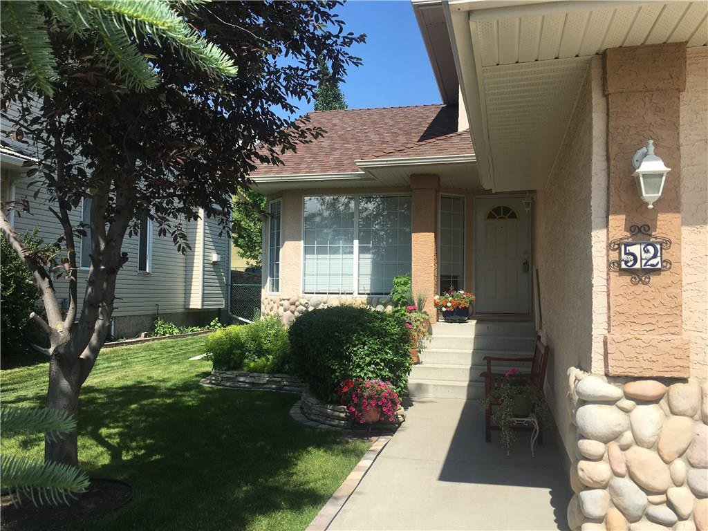 Photo 2: Photos: 52 GLENEAGLES View: Cochrane House for sale : MLS®# C4125774