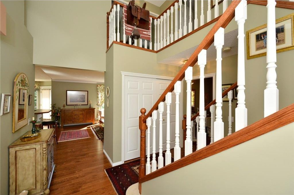 Photo 4: Photos: 52 GLENEAGLES View: Cochrane House for sale : MLS®# C4125774