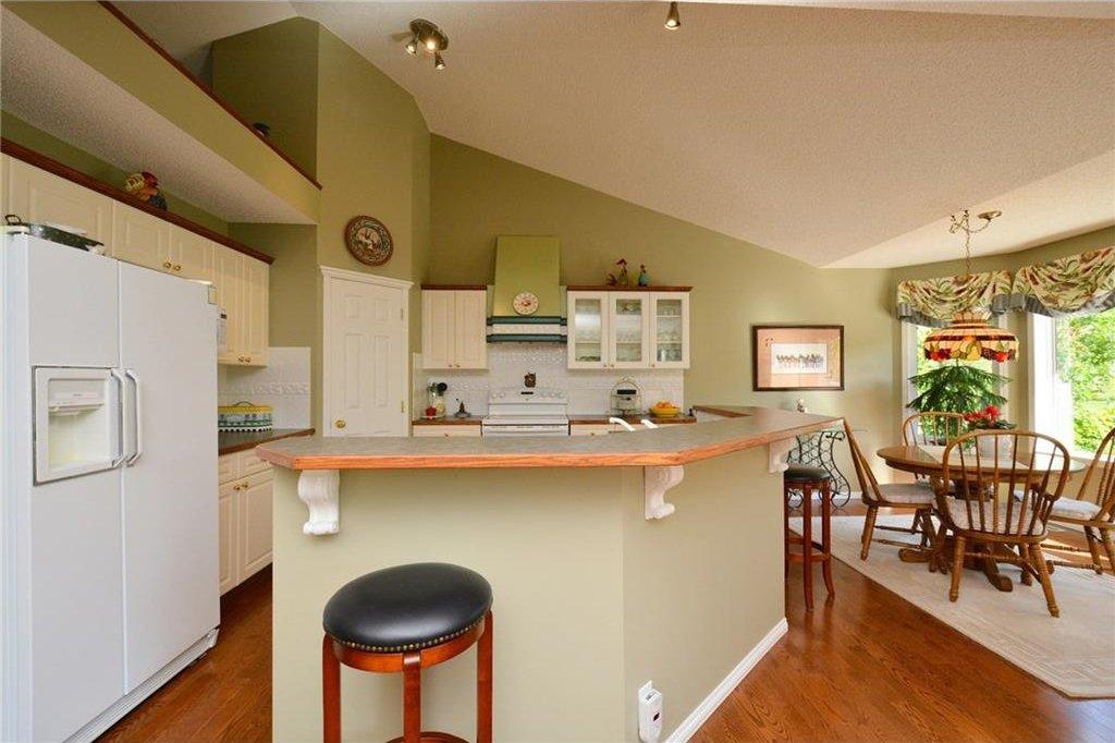 Photo 10: Photos: 52 GLENEAGLES View: Cochrane House for sale : MLS®# C4125774