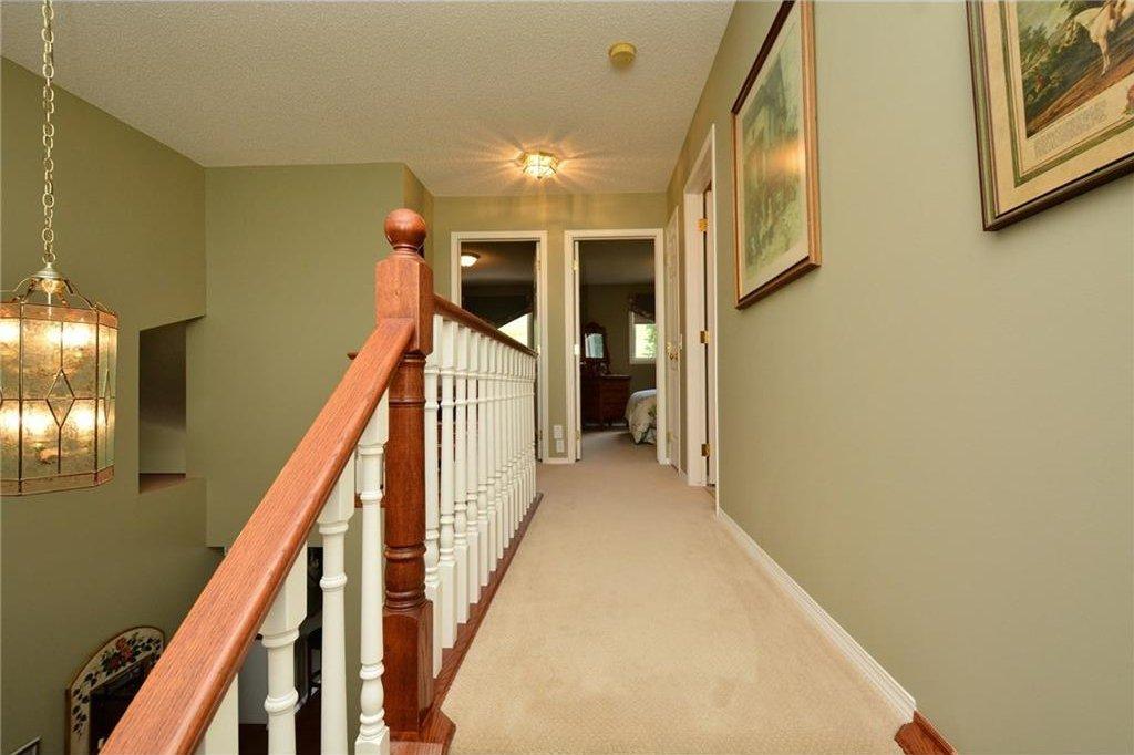 Photo 28: Photos: 52 GLENEAGLES View: Cochrane House for sale : MLS®# C4125774