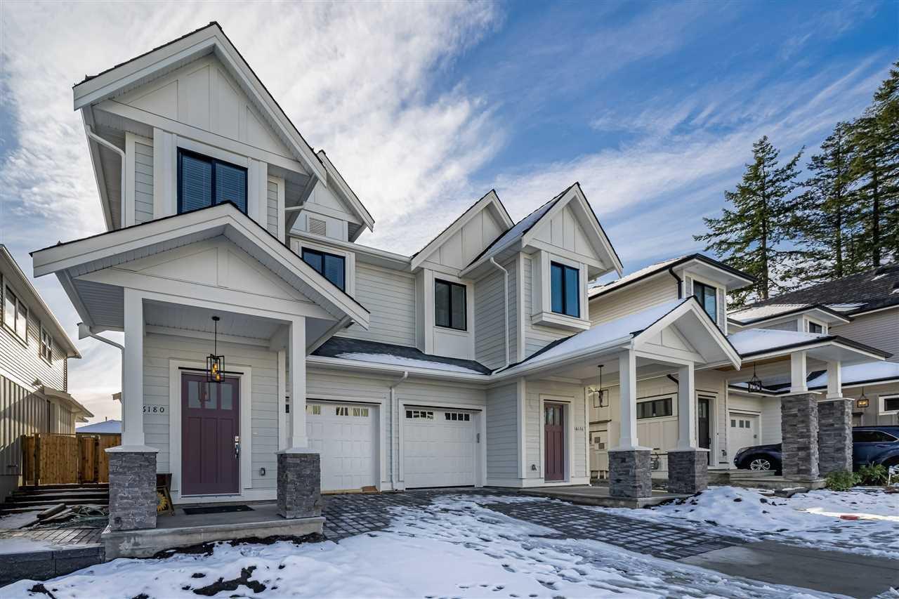 Main Photo: 16184 87 Avenue in Surrey: Fleetwood Tynehead House 1/2 Duplex for sale : MLS®# R2448914