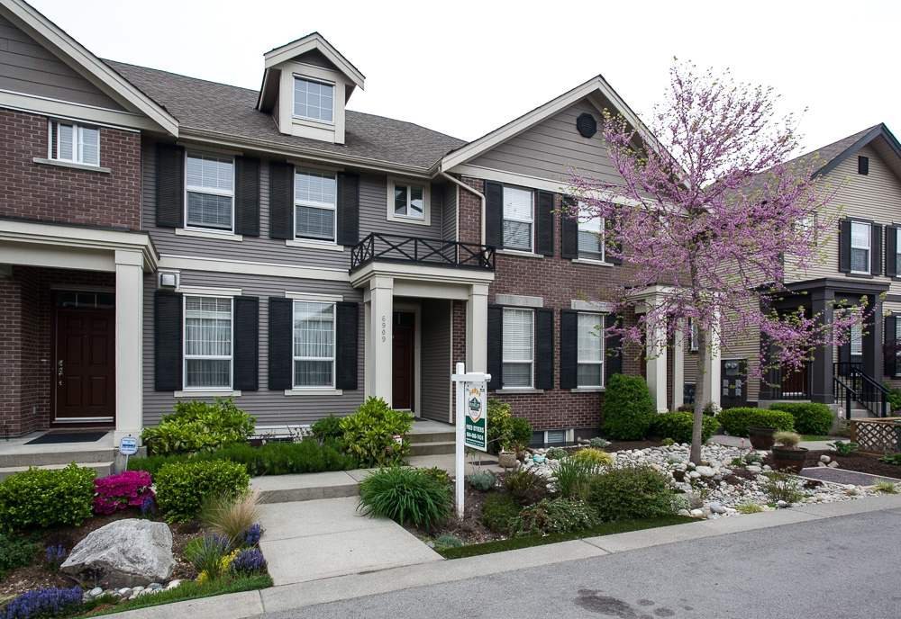 """Main Photo: 6909 208A Street in Langley: Willoughby Heights Condo for sale in """"Milner Heights"""" : MLS®# R2059980"""