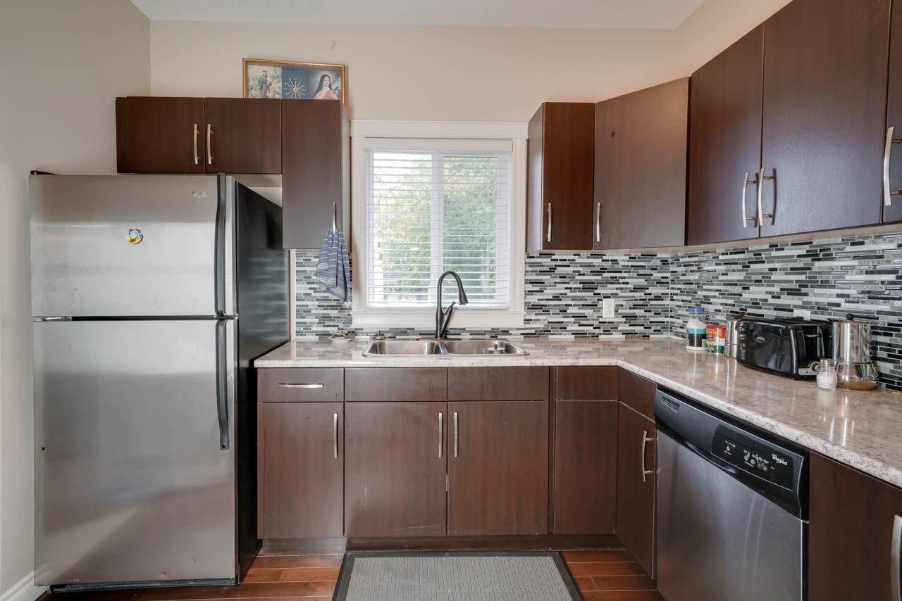 Main Photo: 11944 53 Street in Edmonton: Zone 06 House Half Duplex for sale : MLS®# E4173324