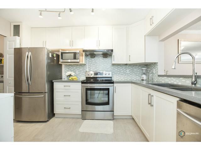 """Main Photo: 122 7453 MOFFATT Road in Richmond: Brighouse South Condo for sale in """"COLONY BAY"""" : MLS®# V1088055"""