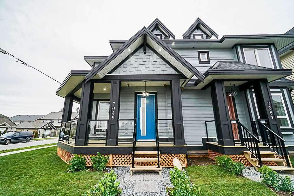 Main Photo: 7050 144A Street in Surrey: East Newton House 1/2 Duplex for sale : MLS®# R2352197