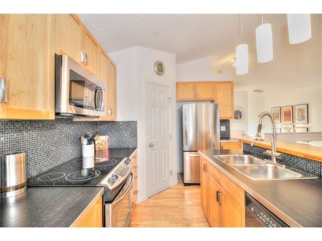 Photo 12: Photos: 670 EVERMEADOW Road SW in Calgary: Evergreen House for sale : MLS®# C4041129