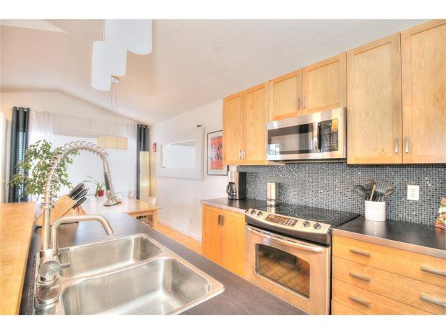 Photo 13: Photos: 670 EVERMEADOW Road SW in Calgary: Evergreen House for sale : MLS®# C4041129