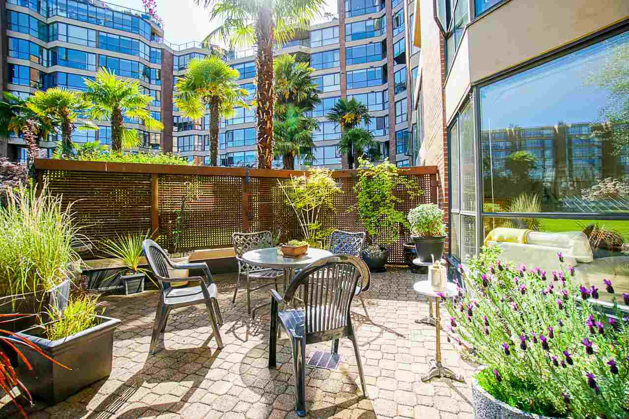 "Main Photo: 108 1450 PENNYFARTHING Drive in Vancouver: False Creek Condo for sale in ""HARBOUR COVE"" (Vancouver West)  : MLS®# R2459679"
