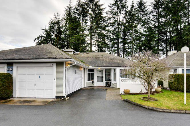 Rarely available rancher townhome in a quiet & very private location