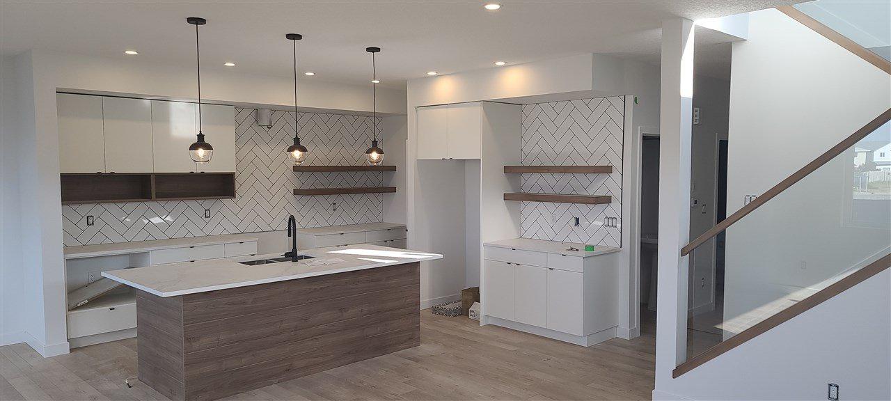 Main Photo: 8105 174A Avenue NW in Edmonton: Zone 28 House Half Duplex for sale : MLS®# E4208052