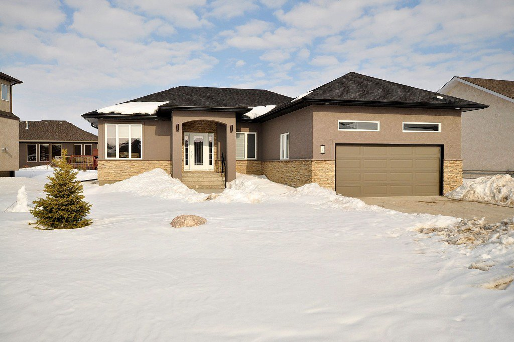 OUTSTANDING Custom Built 1450 sf 3 Bedroom Bungalow (11), AT2 22x22, Beautifully Landscaped Pie Lot on Cherry Tree Lane in Desirable Aspen Lakes Development in Town of Oakbank.