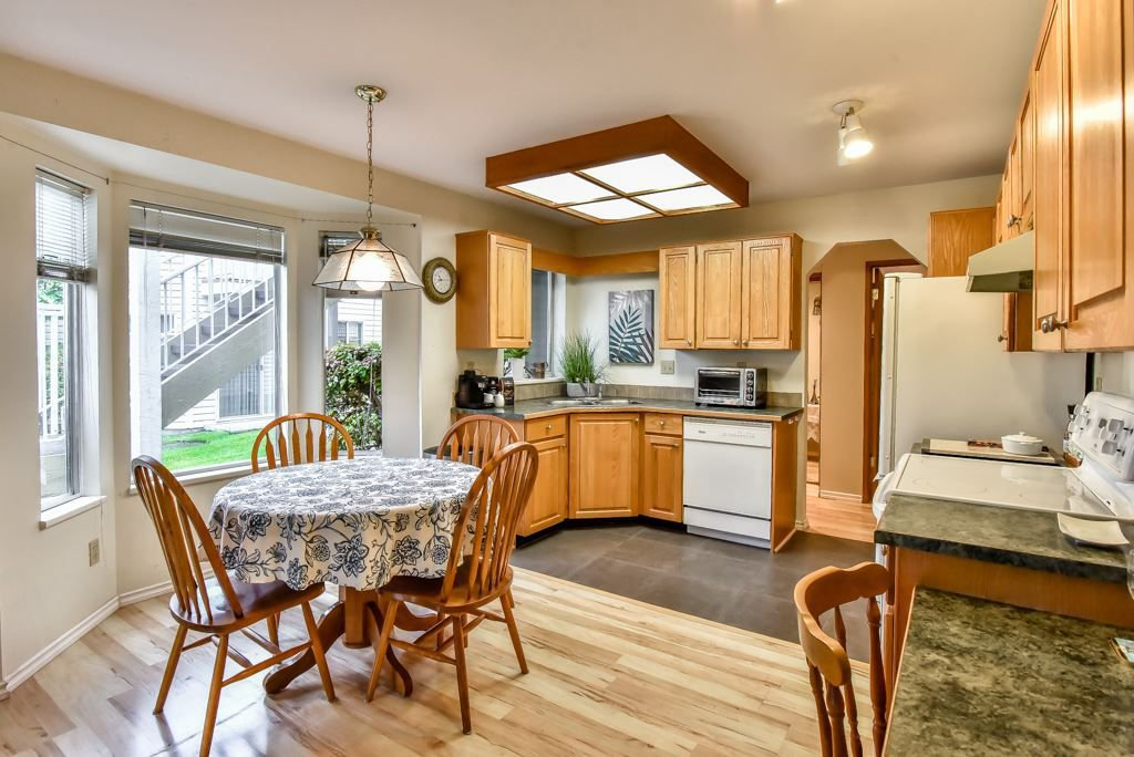 """Photo 5: Photos: 105 10584 153RD Street in Surrey: Guildford Townhouse for sale in """"Glenwood Village"""" (North Surrey)  : MLS®# R2266261"""