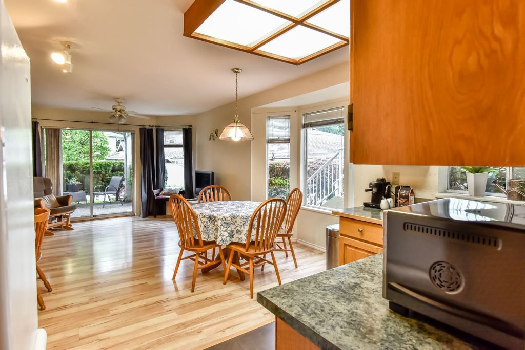 """Photo 3: Photos: 105 10584 153RD Street in Surrey: Guildford Townhouse for sale in """"Glenwood Village"""" (North Surrey)  : MLS®# R2266261"""