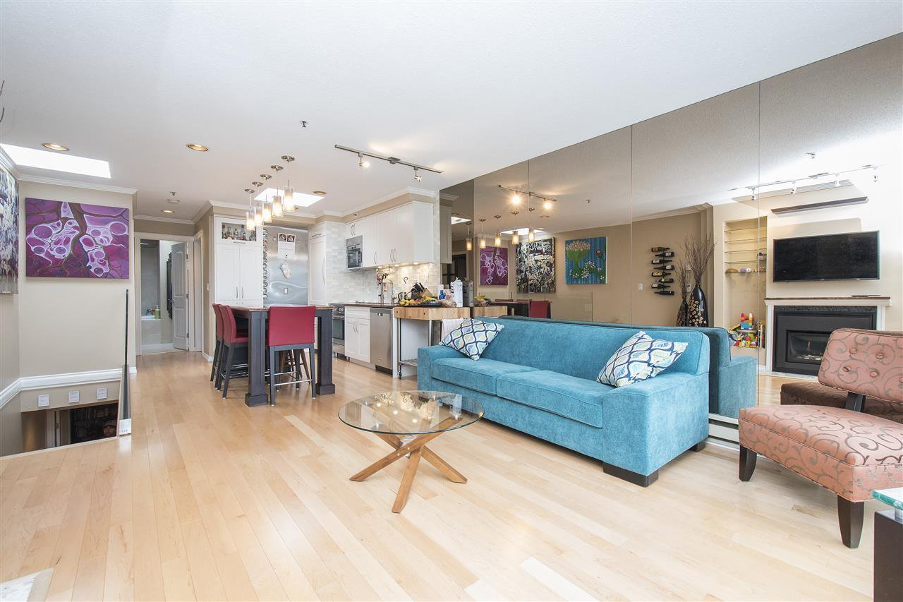 """Main Photo: 7 973 W 7TH Avenue in Vancouver: Fairview VW Condo for sale in """"SEAWINDS"""" (Vancouver West)  : MLS®# R2338483"""