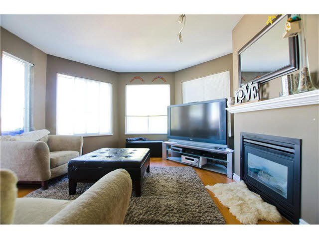 """Photo 1: Photos: 306 5759 GLOVER Road in Langley: Langley City Condo for sale in """"College Court"""" : MLS®# F1430779"""