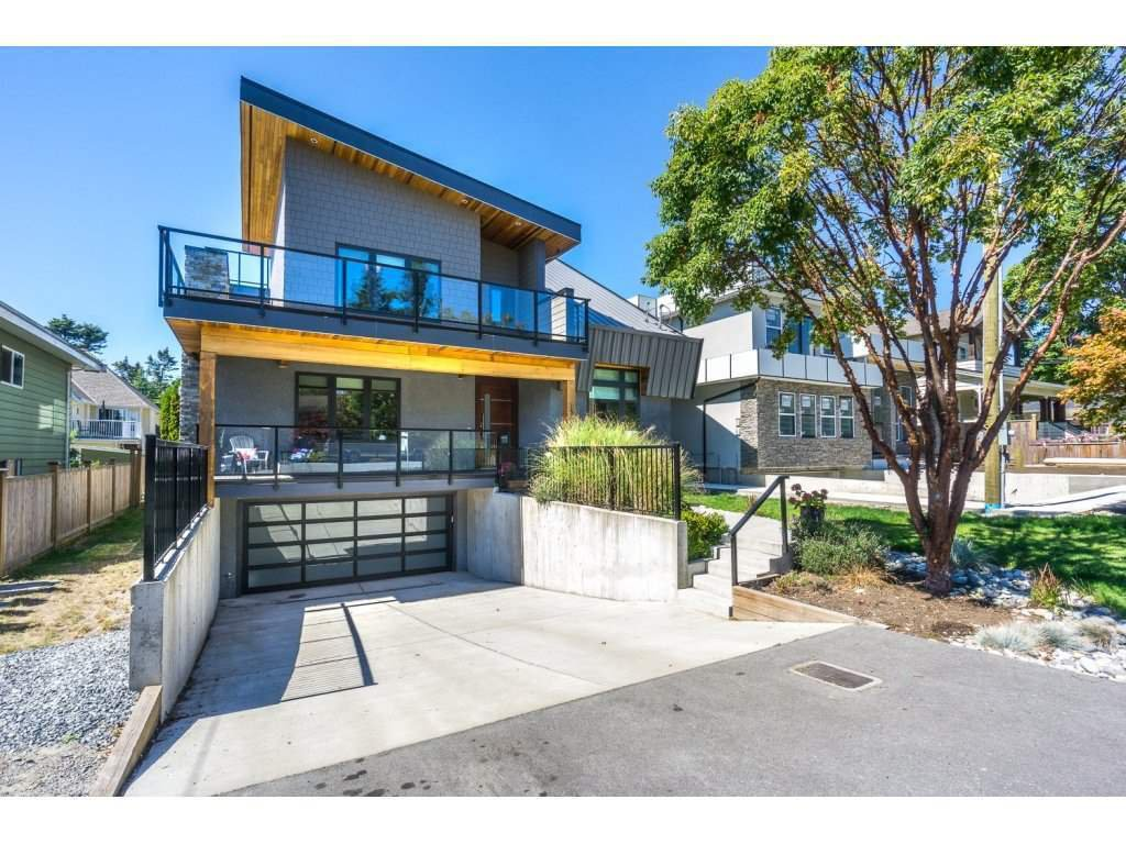 "Main Photo: 1345 129B Street in Surrey: Crescent Bch Ocean Pk. House for sale in ""Ocean Park Village"" (South Surrey White Rock)  : MLS®# R2126954"