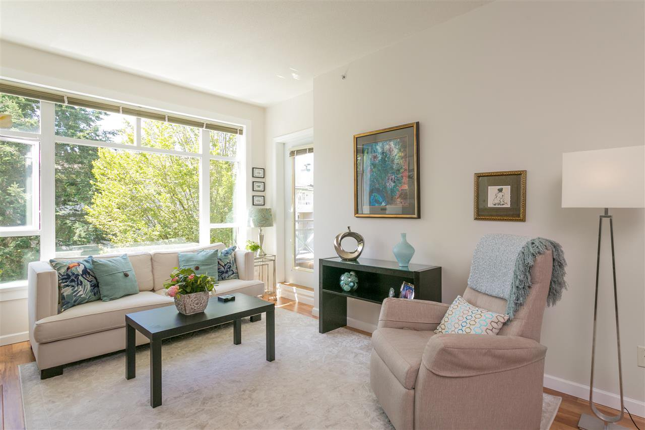 """Photo 2: Photos: 307 3600 WINDCREST Drive in North Vancouver: Roche Point Condo for sale in """"WINDSONG AT RAVENWOODS"""" : MLS®# R2381678"""