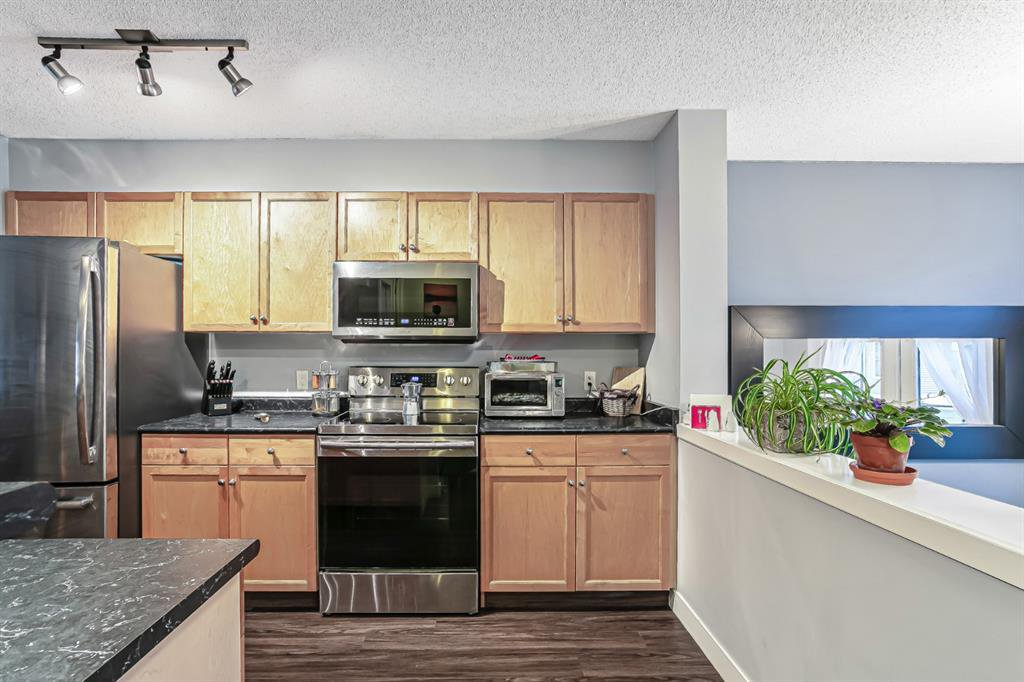 Photo 7: Photos: 177 Mckenzie Towne Gate SE in Calgary: McKenzie Towne Row/Townhouse for sale : MLS®# A1043224