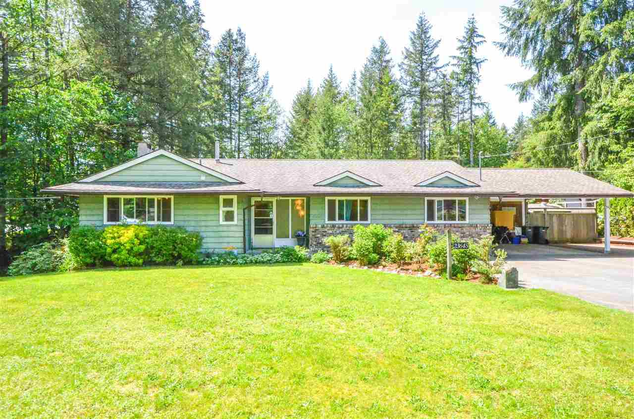Large flat front yard, double carport with ample extra parking for RV