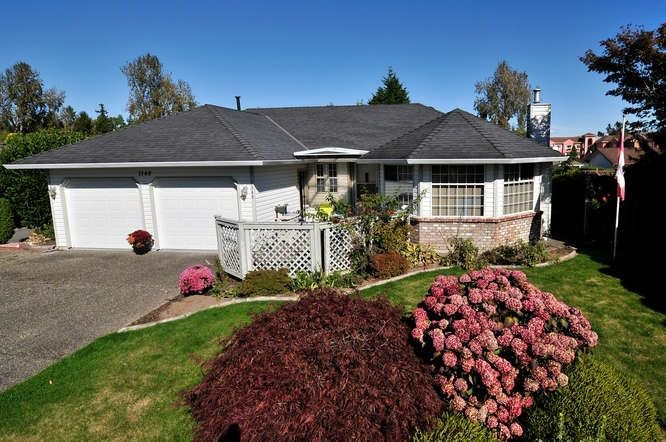 McNally Creek Rancher on a 7035sf lot!  New roof in 2010. Two car garage and room for more in the driveway