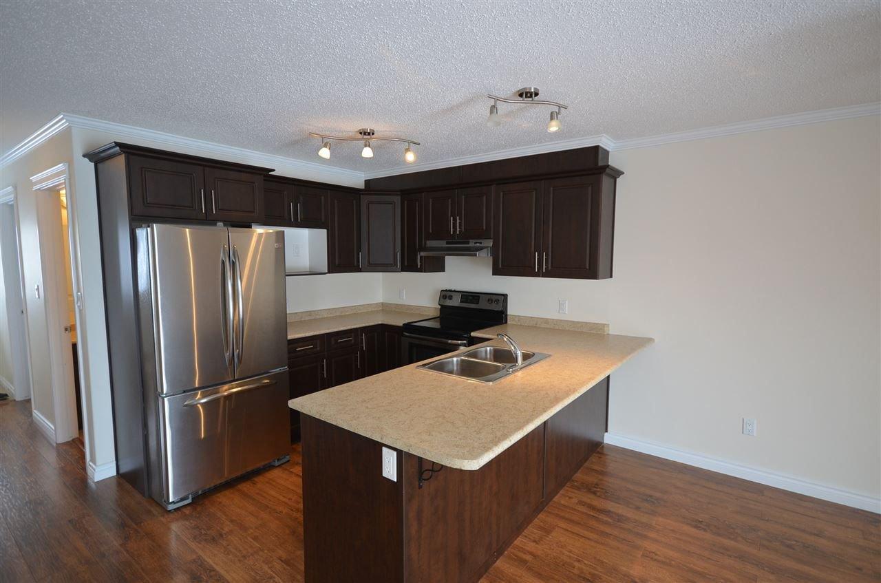 Photo 2: Photos: 11407 89A Street in Fort St. John: Fort St. John - City NE House 1/2 Duplex for sale (Fort St. John (Zone 60))  : MLS®# R2143713
