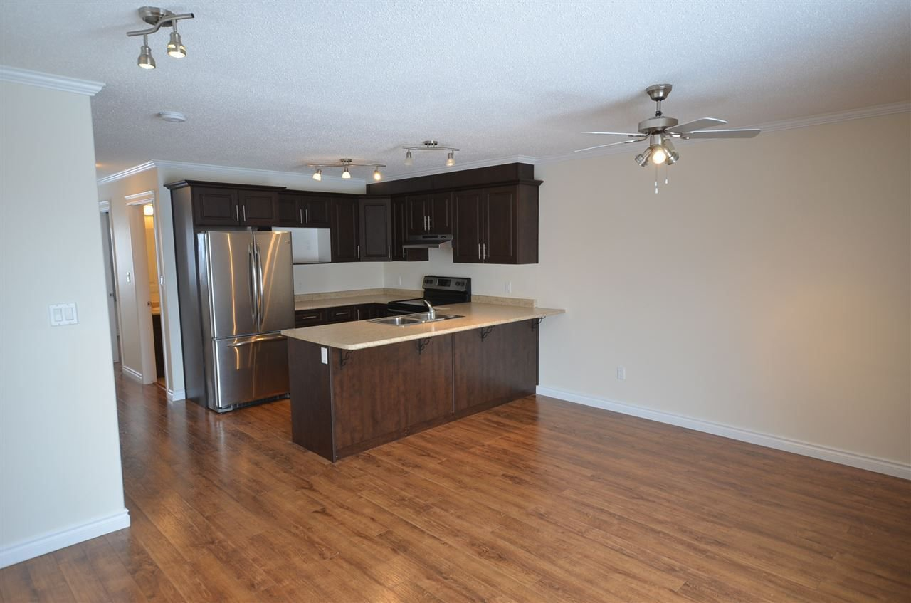 Photo 4: Photos: 11407 89A Street in Fort St. John: Fort St. John - City NE House 1/2 Duplex for sale (Fort St. John (Zone 60))  : MLS®# R2143713