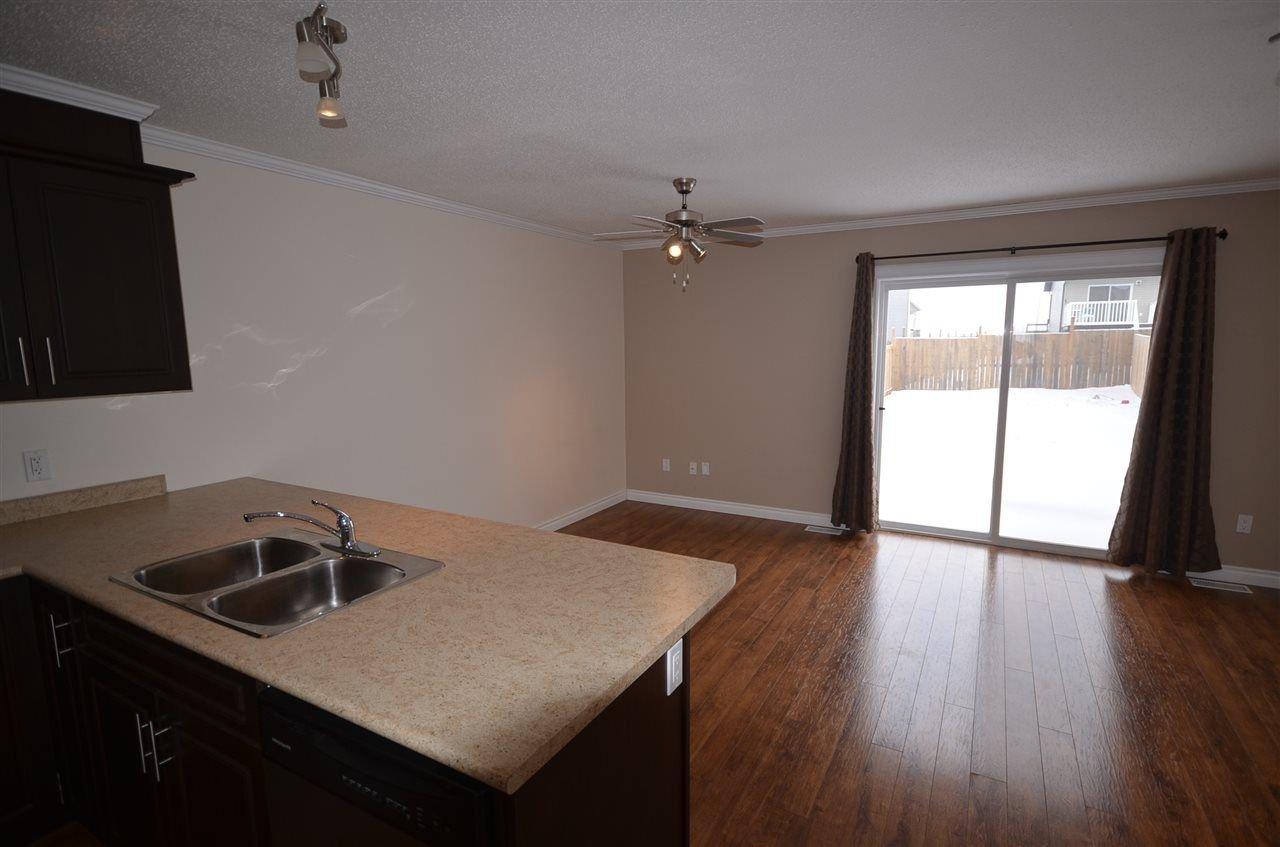 Photo 3: Photos: 11407 89A Street in Fort St. John: Fort St. John - City NE House 1/2 Duplex for sale (Fort St. John (Zone 60))  : MLS®# R2143713