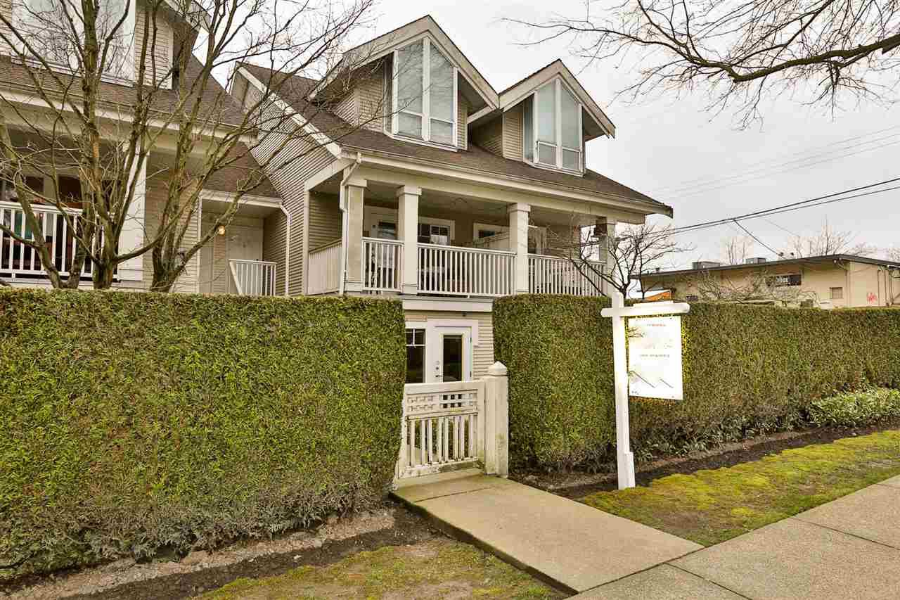 """Main Photo: 2416 E 8TH Avenue in Vancouver: Renfrew VE Townhouse for sale in """"8th Avenue Garden Apartments"""" (Vancouver East)  : MLS®# R2447479"""