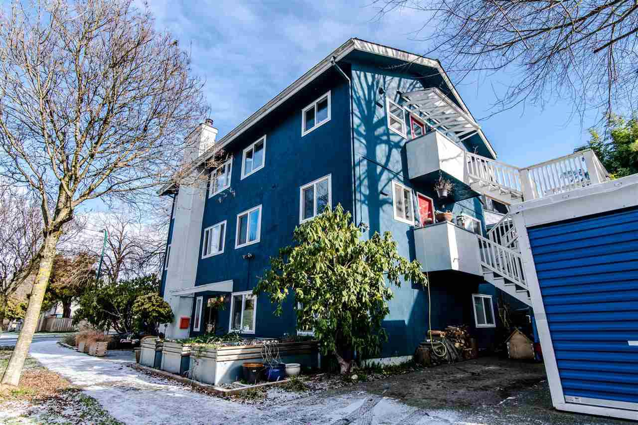 This townhomes occupies the house first floor of this triplex on a corner lot.
