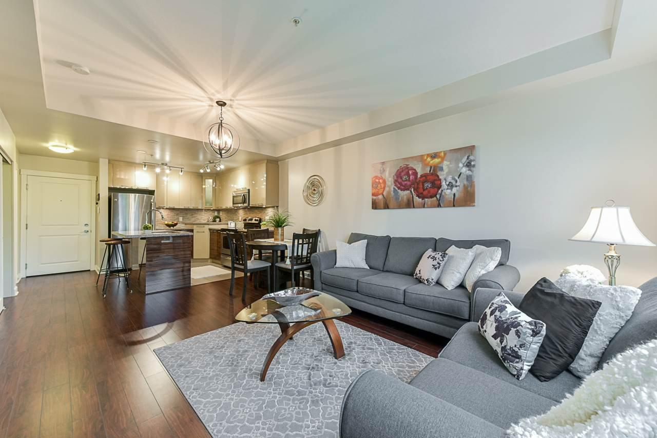 "Main Photo: 103 12039 64 Avenue in Surrey: West Newton Condo for sale in ""LUXOR"" : MLS®# R2360945"
