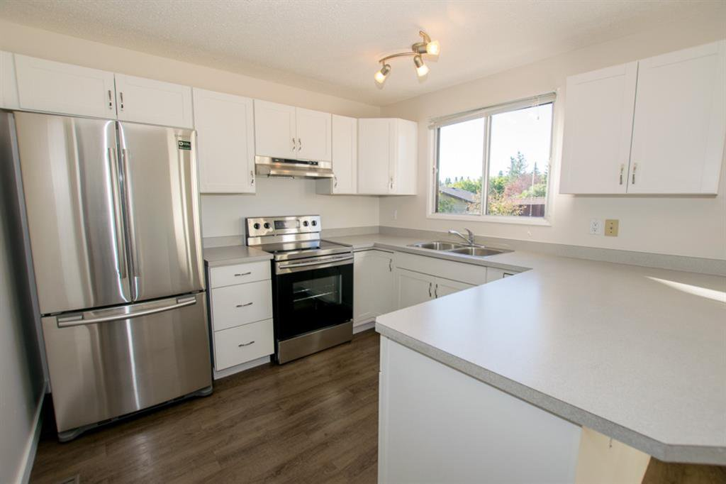 Main Photo: 79 COACHWAY Road SW in Calgary: Coach Hill Semi Detached for sale : MLS®# A1032445