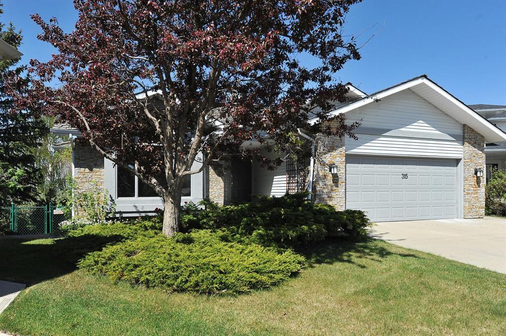 Main Photo: 315 Hawkdale Bay NW in Calgary: Hawkwood Detached for sale : MLS®# A1057091