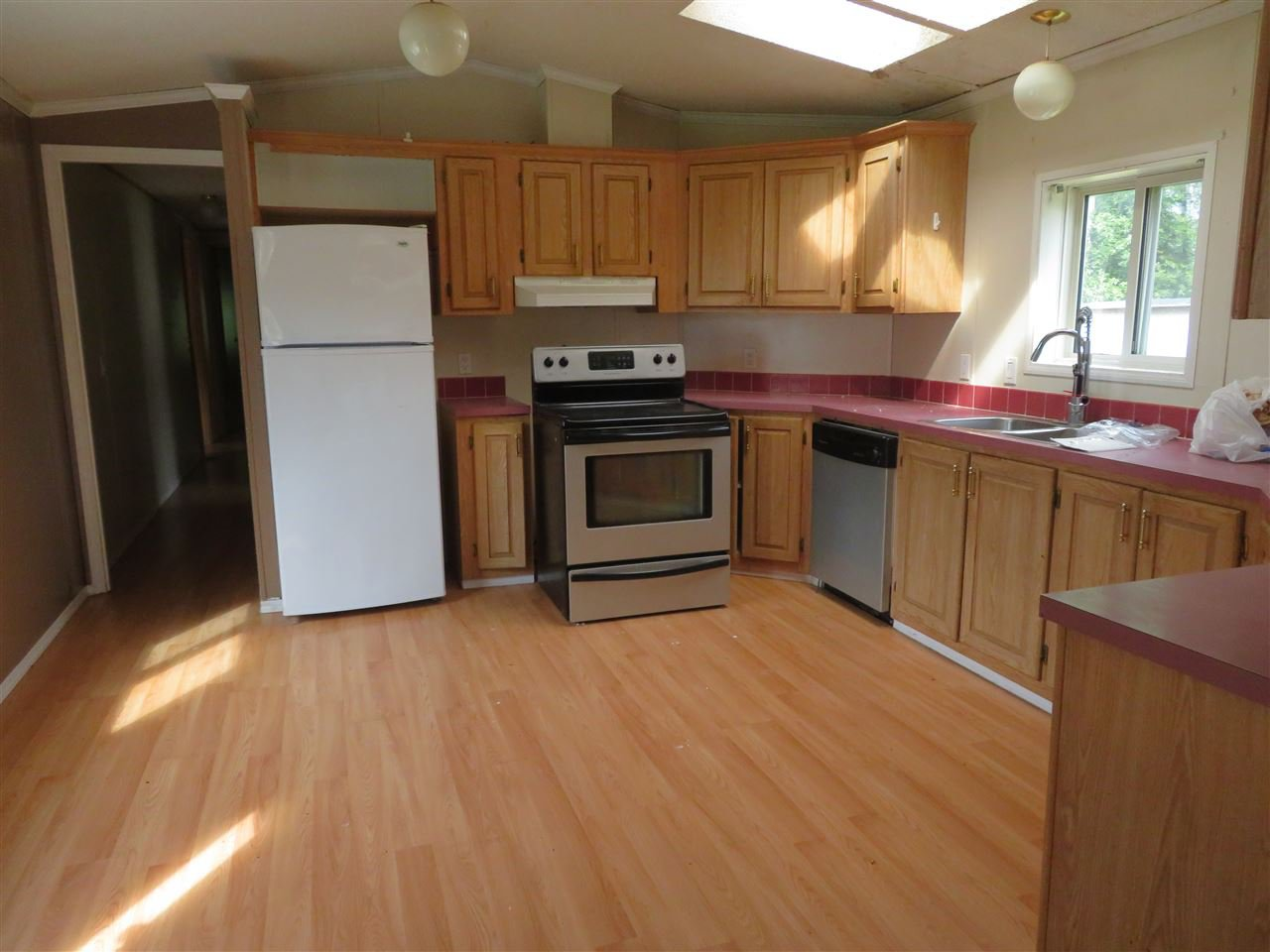 """Photo 5: Photos: 31 2963 KLAHANNI Drive in Fort Nelson: Fort Nelson -Town Manufactured Home for sale in """"KLAHANNI PARK"""" (Fort Nelson (Zone 64))  : MLS®# R2377854"""