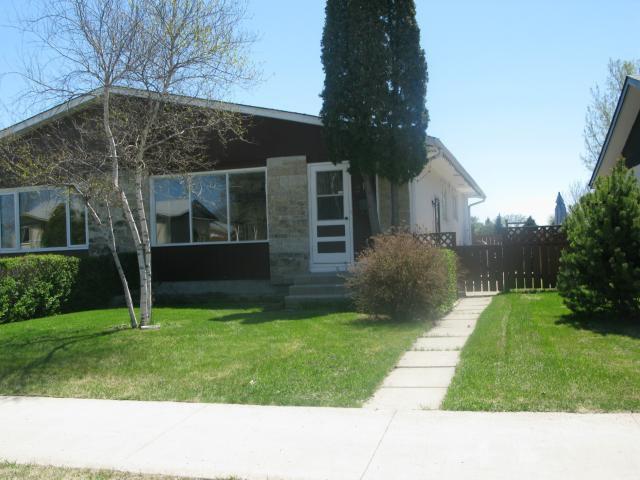Main Photo: 210 Tu-pelo Avenue in WINNIPEG: East Kildonan Single Family Attached for sale (North East Winnipeg)  : MLS®# 1310231