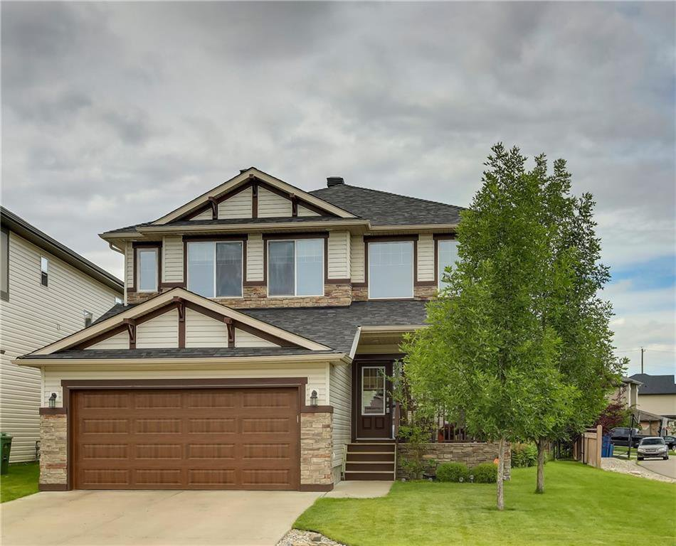 Welcome to 125 Chaparral Ravine View - located on a quiet cul-de-sac on a large corner lot with NO SIDEWALK to shovel.