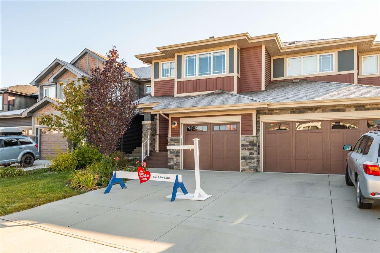 Main Photo: 8805 221 Street in Edmonton: Zone 58 House Half Duplex for sale : MLS®# E4176031
