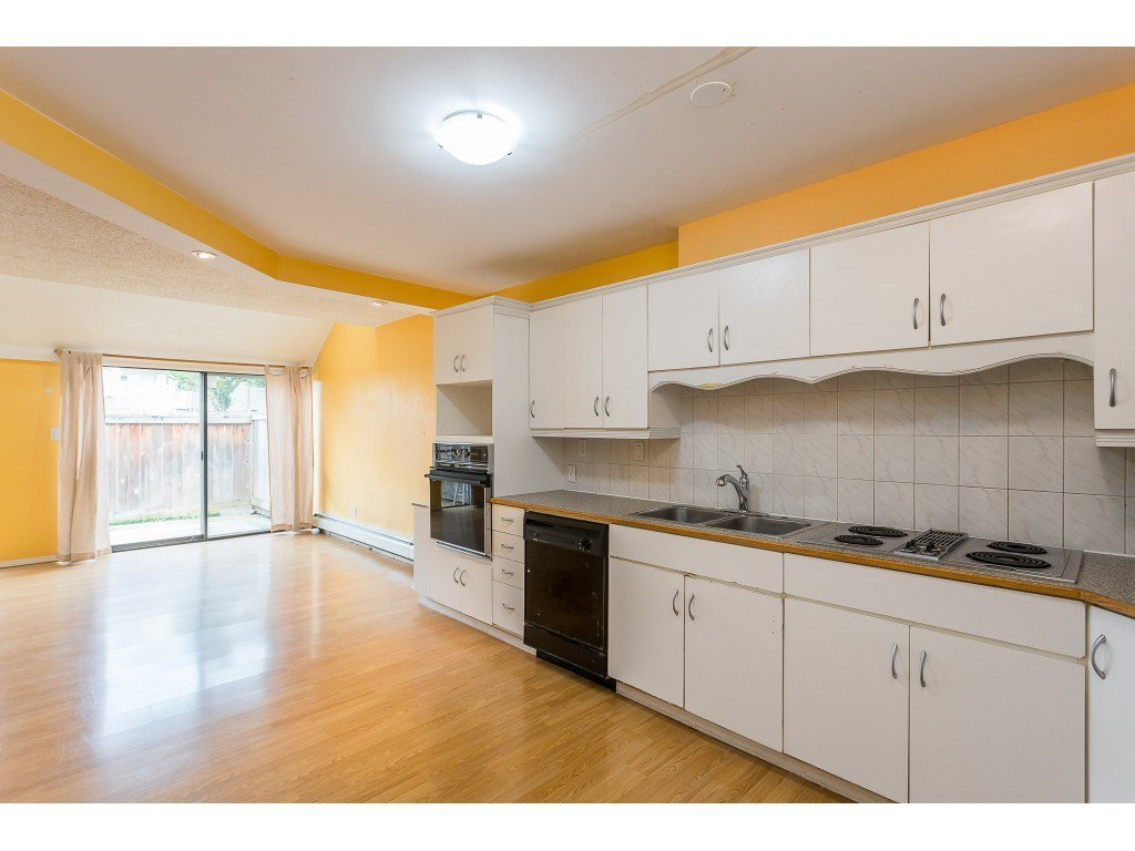 """Main Photo: 102 17718 60 Avenue in Surrey: Cloverdale BC Townhouse for sale in """"CLOVER PARK GARDENS"""" (Cloverdale)  : MLS®# R2498057"""