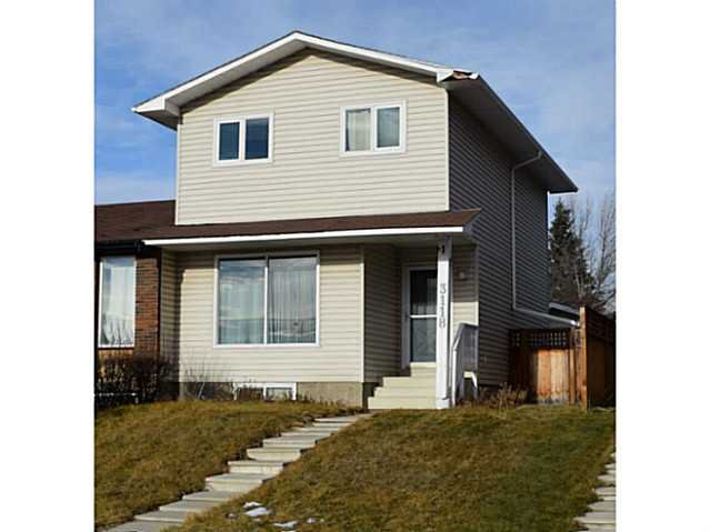Main Photo: 3118 109 Avenue SW in Calgary: Cedarbrae Residential Attached for sale : MLS®# C3646421