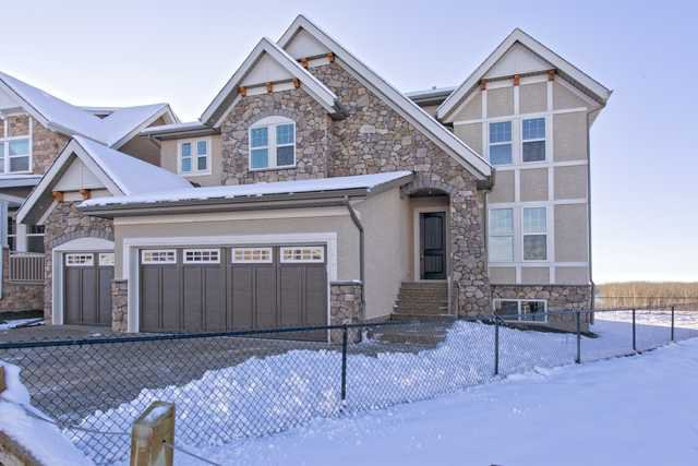 Stunning upgraded executive home on a pie lot backing west onto a green space on a quiet street with panoramic mountain views.