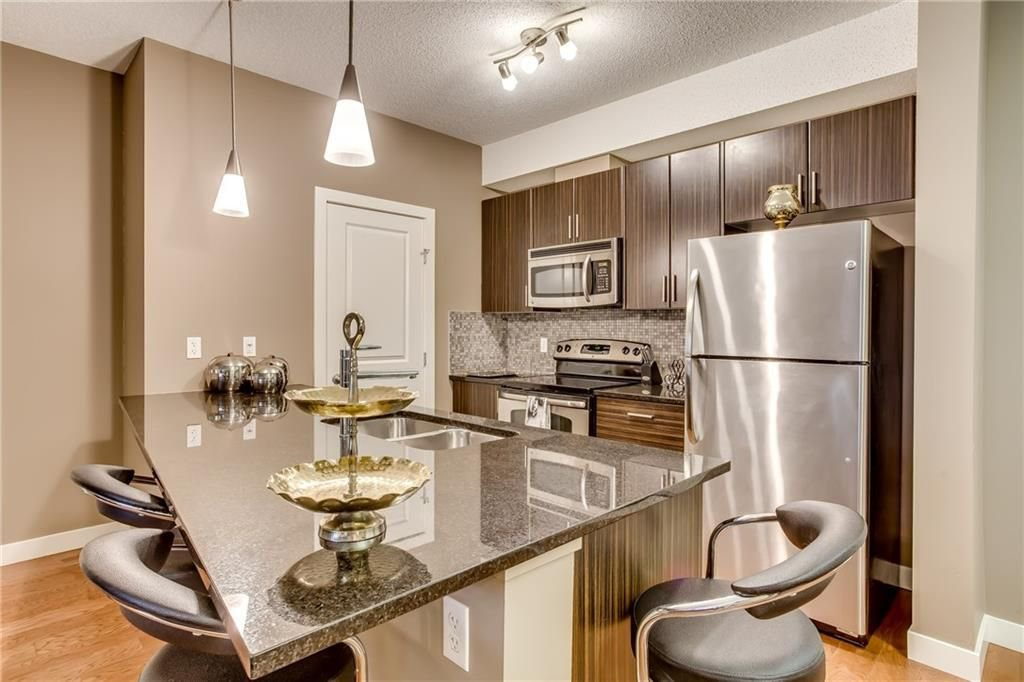 Photo 4: Photos: 336 23 MILLRISE Drive SW in Calgary: Millrise Condo for sale : MLS®# C4183839