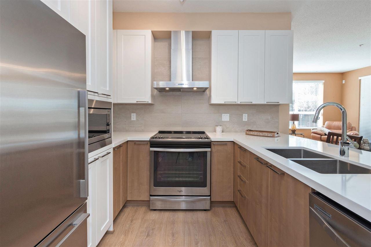 """Main Photo: 106 611 REGAN Avenue in Coquitlam: Coquitlam West Condo for sale in """"Regan's Walk"""" : MLS®# R2354478"""